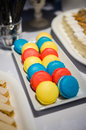 Macarons at a food buffet of all varieties in plate Stock Image