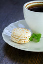 Macaroon and a cup of coffee one vanilla Royalty Free Stock Image