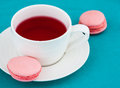 Macaroon and cup of herbal tea Royalty Free Stock Photos