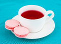 Macaroon and cup of herbal tea Stock Images