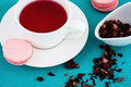 Macaroon and herbal tea Stock Image