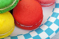 Macaroon macro closeup of brightly colored cookies on a plate edged in a blue and white checker Royalty Free Stock Image