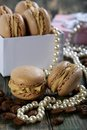 Macaroons in the box pearls and coffee beans on old desk Royalty Free Stock Images