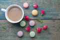 Macaroons, coffee and rose on green wooden background. Top view. Flat lay Royalty Free Stock Photo