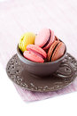 Macaroons colorful in brown cup on white background Royalty Free Stock Photography