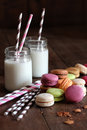 Macaroons with jar glasses and straws Royalty Free Stock Photo