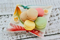 Macaroons multicolored macaroon on the color plate Royalty Free Stock Photos