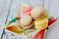 Macaroons multicolored macaroon on the color plate Royalty Free Stock Images