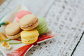 Macaroons multicolored macaroon on the color plate Stock Photos