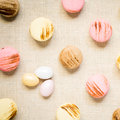 Macaroons with sweet eggs on a linen napkin top view square warm color Stock Photography