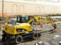 Machine laying rail track Royalty Free Stock Photo