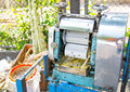 Machine for make a fresh cane juice with  sugar cane press rolle Royalty Free Stock Photo