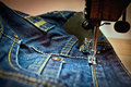 A machine sewing a jean Royalty Free Stock Photo