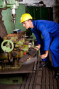 Machinist operating machine tool Stock Images