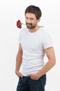 Macho men handsome young man with a rose in his mouth smiling at camera while standing isolated on white Royalty Free Stock Photography