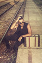 Macho men waiting for a train young man Royalty Free Stock Photos