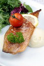 Mackerel fillet with tomato on mash potato Stock Images