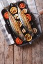 Mackerel fish and vegetables in a pan grill. vertical top view Royalty Free Stock Photo