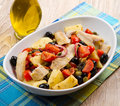 Mackerels salad with potatoes tomatoes capers and olives Stock Photo