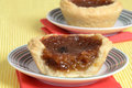 Macro of a butter tart on plate with red napkin Stock Photography