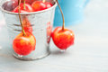 Macro of cherries on grey wooden background in tin can Royalty Free Stock Photo