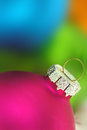 Macro christmas ball shot with colorful abstract background Royalty Free Stock Photo