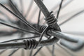 Macro close up of metal wire twisting for wheel construction made rods Royalty Free Stock Image