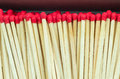 Macro close up of Red headed matches standing upright Royalty Free Stock Photo