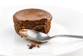 Macro closeup of half eaten chocolate cake muffin with spoon dirty Royalty Free Stock Images