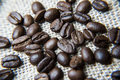 Macro coffee beans on the burlap Royalty Free Stock Photo