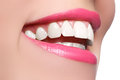 Macro happy woman's smile with healthy white teeth, bright pink .lips make-up. Stomatology and beauty care. Woman smiling Royalty Free Stock Photo