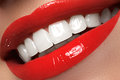Macro happy woman's smile with healthy white teeth, bright red l Royalty Free Stock Photo