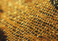 Macro image of decorative asian fabric with metal shiny threads Stock Photos