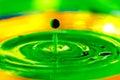 Macro liquid paint drops splashing in water Royalty Free Stock Photo