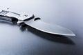 Macro Of An Opened Military Knife On Dark Ground