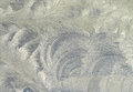 Macro patterns of frost on the window glass