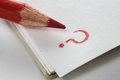 Macro pencil and a question mark Royalty Free Stock Photo