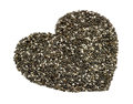 Macro perspective of natural chia seeds in heart shape on white background Royalty Free Stock Images