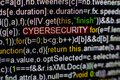 Macro photo of computer screen with program source code and highlighted CYBERSECURITY inscription in the middle. Script Royalty Free Stock Photo