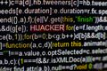 Macro photo of computer screen with program source code and highlighted HIJACKER inscription in the middle. Script on Royalty Free Stock Photo