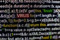 Macro photo of computer screen with program source code and highlighted VIRUS inscription in the middle. Script on the Royalty Free Stock Photo