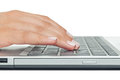 Macro photo of female hand typing on laptop Royalty Free Stock Photo