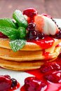 Macro photo of pancakes with strawberry and black currant