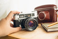Macro photo of retro manual camera and leather case on table lying Royalty Free Stock Images