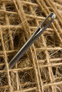 Macro picture of sewing needle in clew Royalty Free Stock Image