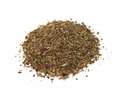 Macro pile of dried basil spice isolated on white Royalty Free Stock Images