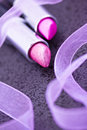 Macro of pink lipsticks on black Royalty Free Stock Photo
