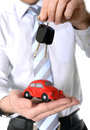 Macro red toy car with car keys in mans hand close up of a and the of a business man wearing a blue shirt and blue tie on a white Royalty Free Stock Photos