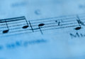 Macro of sheet music in blue tones Royalty Free Stock Photo