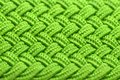Macro shot bright green interwoven fabric texture – horizontal orientation Royalty Free Stock Images